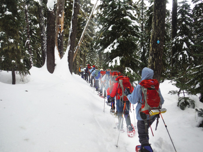 Anne Bentley, associate professor of chemistry, took students on a snowshoe hike to an ice cave on Mount Adams to learn about ice crystal formation. (College Outdoors)