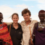 Rebecca Moran and her husband, Ezra Jay, with two Maasai brothers who have become their friends.