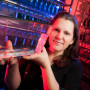 Weissman-Unni holds a small tank of zebrafish. Weissman-Unni's neurobiology training focused on...