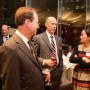 Yan Jiang J.D. '01 speaks with Robert Klonoff (center), dean of Lewis & Clark Law School, a...