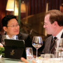Jun Ge J.D. '95 talks with President Glassner at the Shanghai alumni event.