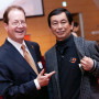 Atsuyoshi Yoshida B.A. '71 shows President Barry Glassner his reunion souvenir from a recent...