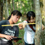 Daphne Yuen and Waseda University student Rina Kojima record tree measurements.