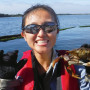 A student from Professor Nilsen's trip shows off her prize catch of a Dungeness crab. (College ...