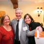 Executive Assistant Moira Domann with Trustee Jon Jaqua and his wife, Kim Cooper. Like the other ...