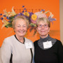 Phyllis Yes (right), professor emerita of art, with Ann Wellman, who donated Yes' painting (sho...