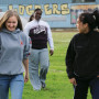 High school students Jessica Willis, Catrice Allyene, and Sarah Ramos head toward a classroom at ...