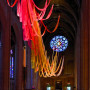 A temporary installation of 50 painted nylon-net strips for Pentecost at Grace Cathedral in San F...