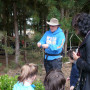 "Bob Carlson interacts with kindergarteners on a ""senses"" walk in the CREST garden."