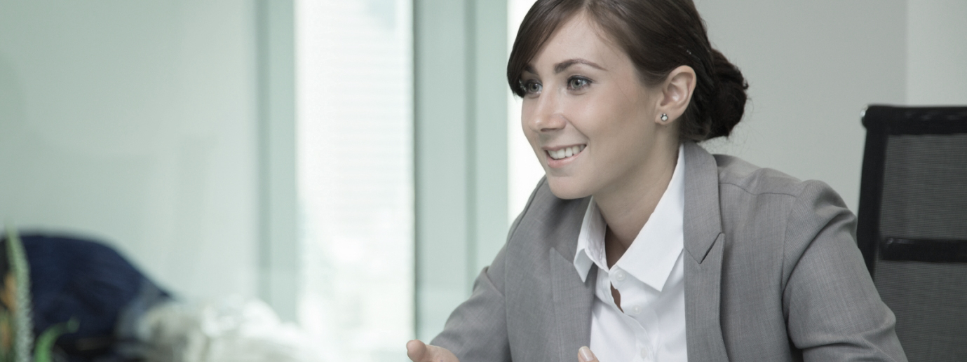 Happy young business woman in meeting