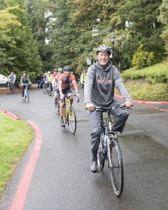 President Wiewel arrives by bike for his first day of work at Lewis & Clark.