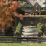 View of the Manor House and reflecting pool on a fall afternoon.