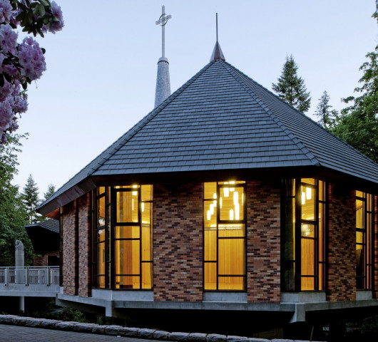 The pavilion extends the exterior palette of the chapel through the use of custom-made brick. To ...
