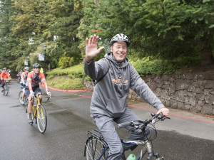 Wim Wiewel leads a community bike ride on his first day as president.