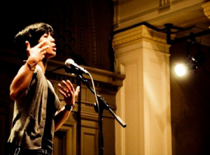 Christabel Escarez '11, performing at a poetry slam. Photo by Marvin Buenaventura.
