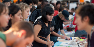 Students sign up for campus activities during the annual Pio Fair.