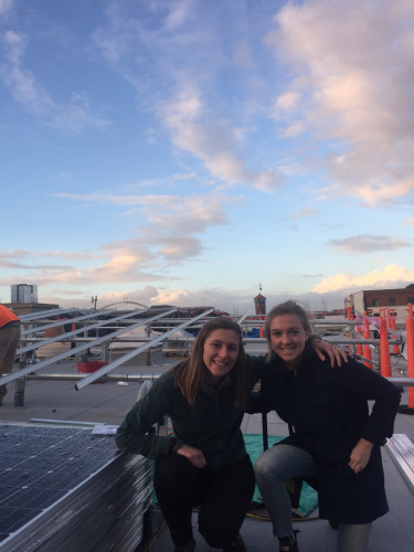 Franny and Kori on the roof of the Sally McCracken Building in Portland.