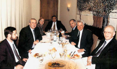 Russia's minister of atomic energy, Aleksandr Rumyantsev, second from left, at a 2002 dinner for Thomas L. Neff, second from right, who had worked with Mr. Rumyantsev on the uranium purchase agreement.