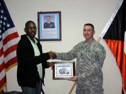 As part of his USO tour in Iraq, Assistant Professor of Counseling Psychology Andraé L. Brown re...