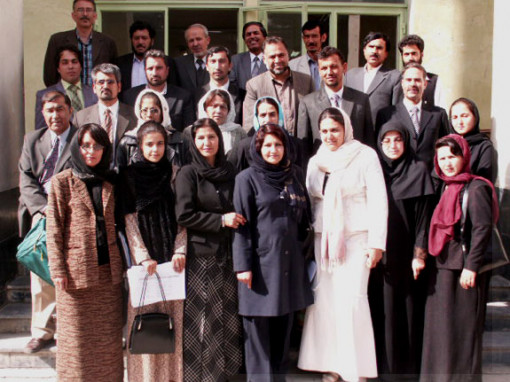 Zaher Wahab (second row on the left), poses with the first cohort of the master's degree for te...