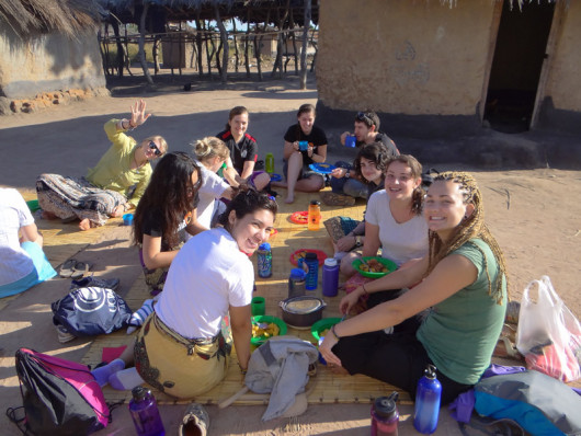 Eating lunch in Mangulu village after a morning spent working on the school.