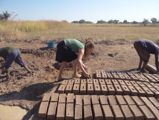 Maddy Kidd ?14 making bricks out of the clay that is naturally found in the village. All bricks u...