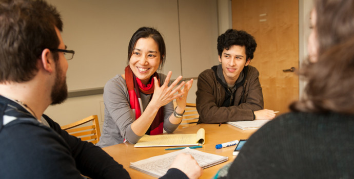 Assistant Professor of English Kristin Fujie meets with students.