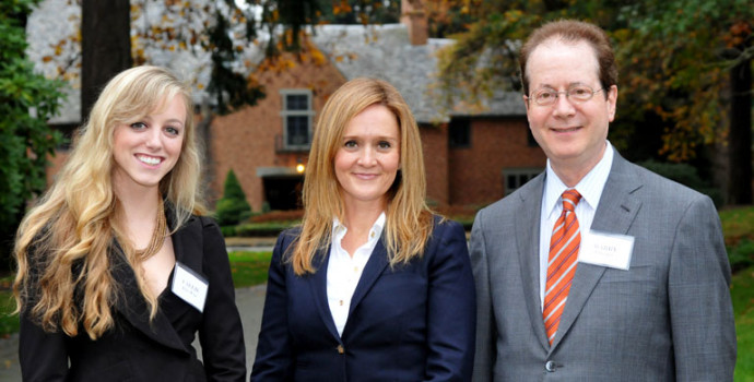 Samantha Bee, center, poses with President Barry Glassner and student government President Callie...