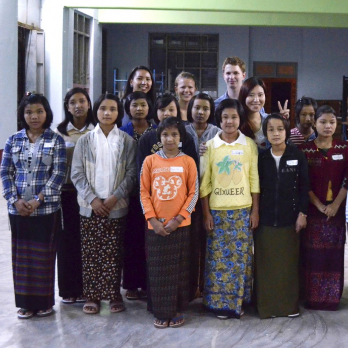 Sam Shugart '15, Nway Khine '15, Katie Schirmer '17, and Ira Yeap '14 with a group of the...