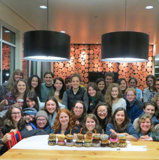 Students celebrate Hannukah on campus with a VooDoo Doughnut menorah.