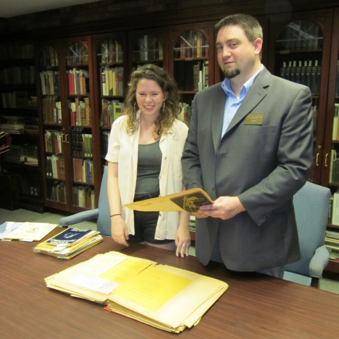 Miriam Karraker '15 with Watzek Special Collections and Archives librarian Jeremy Skinner.
