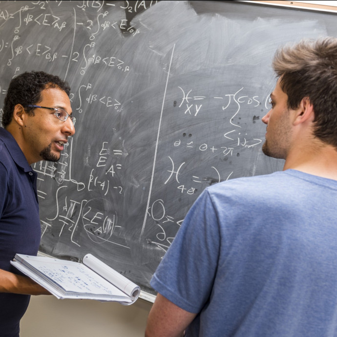 Physics professor Mohamed Anber and physics major Ben Kolligs '18 work through a theoretical phys...