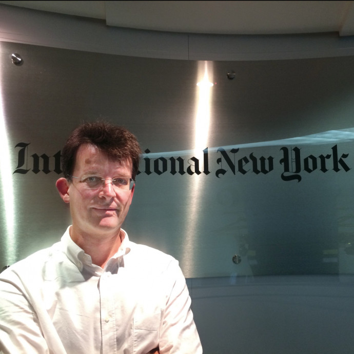 Philip McClellan B.A. '91 at the International New York Times office in Hong Kong.
