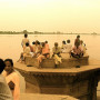 Observers of the rising Yamuna River at Keshi Ghat, Vrindavan