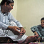 Zaher Wahab, relaxing at home in Kabul with his nephew's son. Here, Wahab is encouraging the bo...