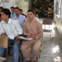 A pile of broken desks sits in the back of this Kabul Education University classroom—symbolic o...