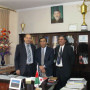 Zaher Wahab (center), poses in the office of the master's degree program at Kabul Education Uni...
