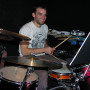 Junior Eli Klemperer, a music psychology major, plays drums in the pit below the Fir Acres Main S...
